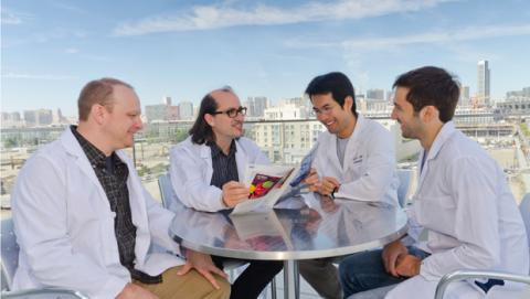 Dr Ruggero and team reading Journal of Nature article