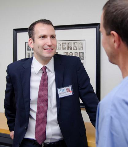 Ben Breyer, MD, MAS, Assistant Professor, speaks with colleague at recent UCSF Urology meeting