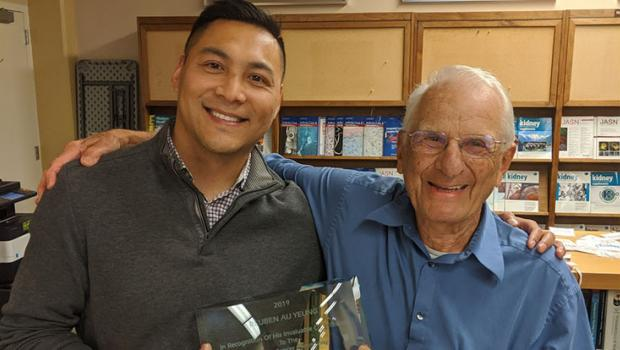 Reuben Au Yeung receives award from Stan Rosenfeld