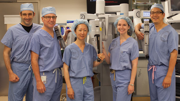 Urology physcians in front of robotics machine